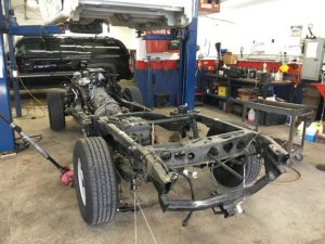 mechanic replaces truck frame