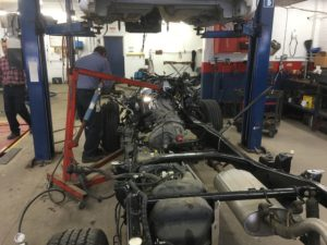 Certified mechanic putting engine in new frame.